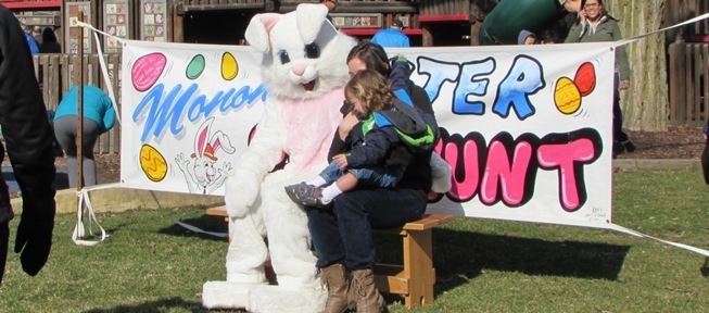 Child and mom with Easter Bunny at Monona Easter Egg Hunt